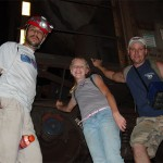 Corey, Caitlyn, and Bill pose with the train