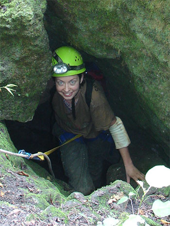 Marsha climbing out the entrance of The Catacombs
